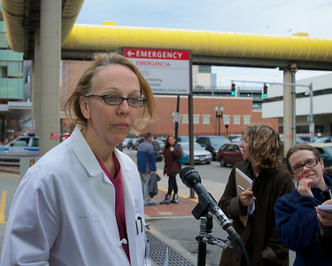 041613, Boston, MA - Dr. Tracey Dechert gives an update on victims of the Boston Marathon bombing outside of the Boston Medical Center's Menino Pavilion. Photo by Ryan Hutton