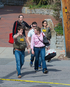 041913, Cambridge, MA - A couple with a cat are evacuated from their apartment at the intersection of Norfolk and Webster Streets. Photo by Ryan Hutton