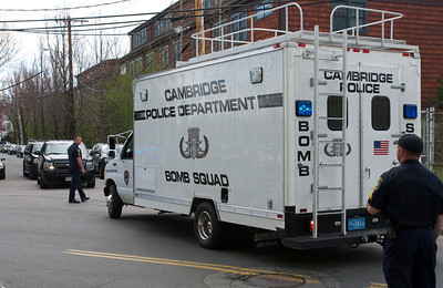 041913, Cambridge, MA - After police had reopened Webster Street to traffic and pedestrians, the Cambridge Police Bomb Squad van backs away from the suspects' home on Norfolk Street. Photo by Ryan Hutton