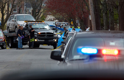 041913, Cambridge, MA - Police haul away a Honda minivan with the license plates covered from in front of 410 Norfolk Street. Photo by Ryan Hutton