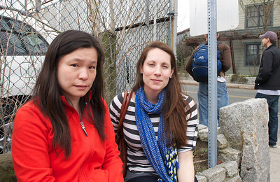 041913, Cambridge, MA - Michelle Li, left, and Erin Miller, right, were neighbors of Boston Marathon bombing suspect Dzhokhar Tsarnaev on Norfolk Street. Photo by Ryan Hutton