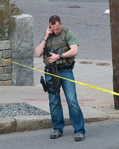 041913, Cambridge, MA - An FBI agent armed with a submachine gun stands guard at the intersection of Norfolk and Webster Streets, Photo by Ryan Hutton