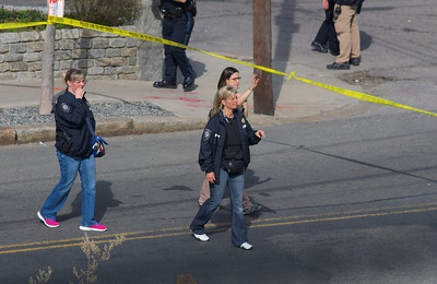 "041913, Cambridge, MA - Cambridge police and an FBI agent wave back spectators after a loud bang was heard in the vicinity of Norfolk Street. Neighbors report hearing police shout ""fire in the hole"" moments before loud bang was heard. Photo by Ryan Hutton"