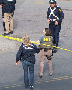 "041913, Cambridge, MA - Cambridge police and an FBI agent secure the intersection of Norfolk Webster Streets after a loud bang was heard in the vicinity of Norfolk Street. Neighbors report hearing police shout ""fire in the hole"" moments before a large bang was heard. Photo by Ryan Hutton"