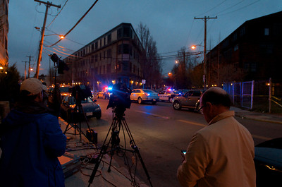 041913, Cambridge, MA - Reporters wait to get access to Norfolk Street as the sun sets and police operations wind down at the Boston Marathon bombing suspects' home at 410 Norfolk Street. Photo by Ryan Hutton