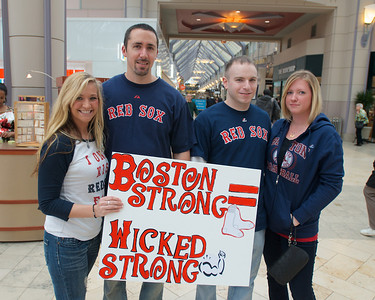 042013, Boston, MA - Mercedes Erickson, 28, of Webster, and her three friends show off the sign she made to bring to Saturday's Red Sox game in celebration of the spirit of Boston. Photo by Ryan Hutton
