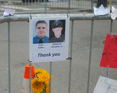 042013, Boston, MA - A simple thank you note left for the police officers who were killed and injured in the confrontation with the Marathon bombers left at the makeshift memorial on Boylston Street, which has been closed since Monday's attack on the Boston Marathon. Photo by Ryan Hutton