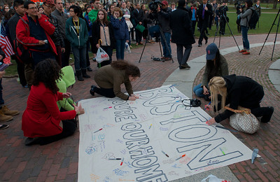 "041613, Boston, MA - People gather at the Boston Common band stand during a vigil for the victims of the Marathon bombing. Here people write personal messages on a sign that says ""Boston you're our home"". Photo by Ryan Hutton"