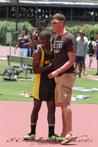 "Coach congratulating Khalil after clearing 6'10"" and breaking the record again."