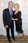 Bette Midler poses with David Yarnold, President & CEO, The National Audubon Society, at the organization's first gala to jointly award the Audubon Medal and the inaugural Dan W. Lufkin Prize for Environmental Leadership, Thursday, Jan. 17, 2013, in New York.  (Photo by Diane Bondareff/Invision for The National Audubon Society)