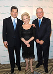 Bette Midler poses with honorees Louis Bacon, left, and George Archibald at The National Audubon Society's first gala to jointly award the Audubon Medal and the inaugural Dan W. Lufkin Prize for Environmental Leadership, Thursday, Jan. 17, 2013, in New York.  (Photo by Diane Bondareff/Invision for The National Audubon Society)