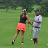 Emily Doyle and her caddie Joe Norman, the head golf professional at Elmira Country Club.