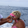 Joy Bell kissing bait aboard the Sea Toy. Submitted by Kristi Waters.