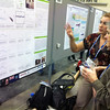 2013 RESESS intern Rachel Medina explains her poster to another scientist at the annual Fall Metting of the American Geophysical Union in San Francisco, Calif.