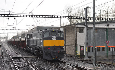 After its trial to Sallins and the wagon transfer to North Wall on Wednesday evening. 077 replaced 081 on the Tara Mines Trains. In dreadful weather it is pictured at passing Fairview EMU Depot with the early running 1915 Alexandra Road - Tara Mines service. This train usually follows the 1650 Bray - Drogheda service. Thurs 11.04.13  Irish Train Scenes were at Laytown and Drogheda to photograph the train: http://smu.gs/ZR9865