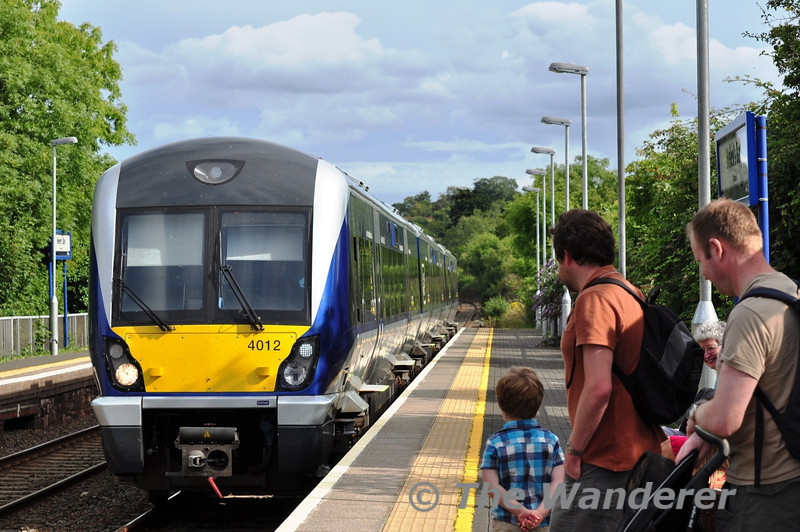Familes wait to join the 1557 Bangor - Portadown service. 4012. Sat 24.08.13