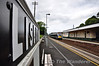 Lisburn Station retains traditional railway station signs. 4007 arrives at the well kept station with the 1015 Portadown - Bangor. Sat 24.08.13