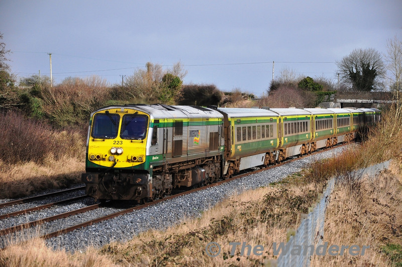 223 passes Rosskelton with the 1200 Heuston - Cork during a brief sunny interlude on Wednesday 14th February 2013.