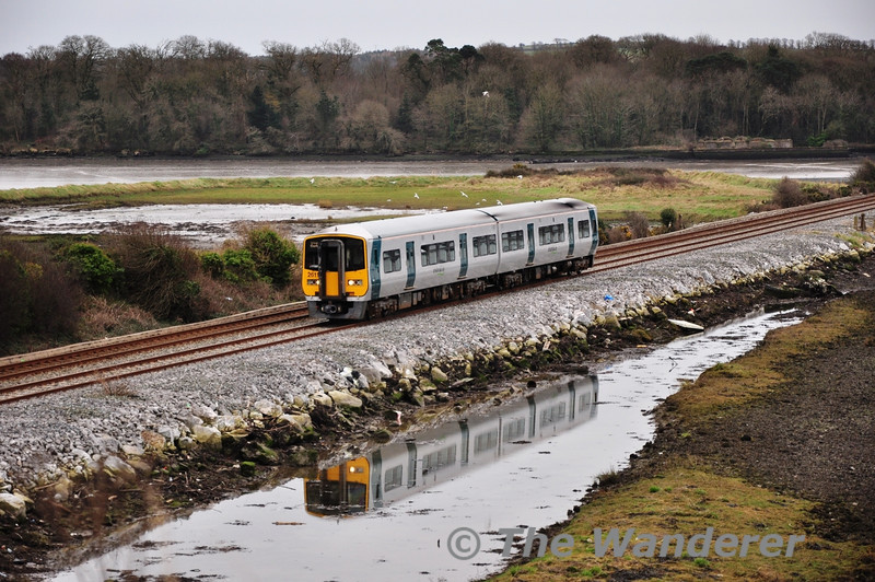 2612 + 2611 is reflected in a pool of water at the N25 overbridge at Harpers Ireland. Tues 12.02.13