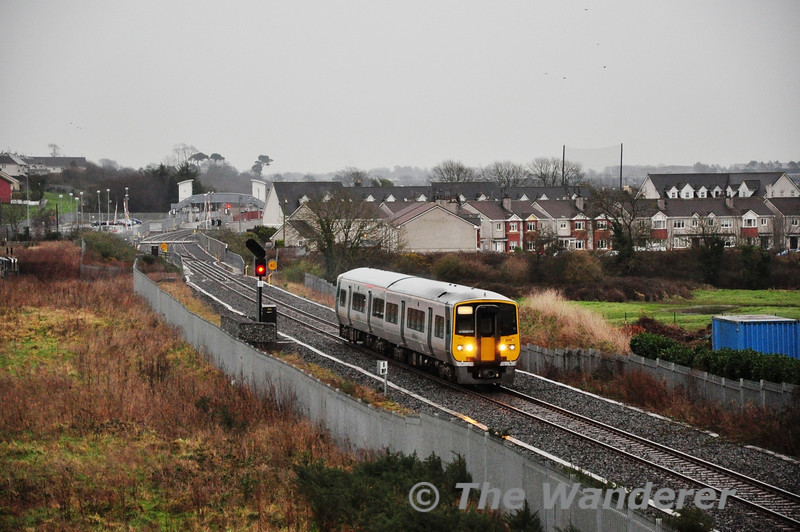 2616 + 2605 heads out of Midleton with the 1645 Midleton - Cork service, as it passes through Knockgriffin. Tues 12.02.13