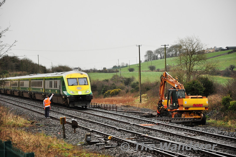 The Lookout Man acknowledges the driver of 4004 as it passes with the 1520 Cork - Heuston. Tues 12.02.13