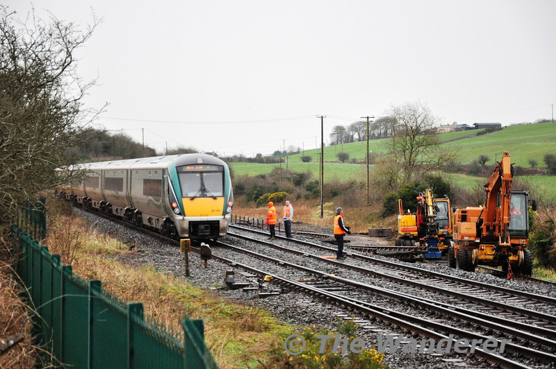 """22040 passes Rathpeacon with the 1300 Heuston - Cork. The former yard is currently having its track lifted. Tues 12.02.13<br /> <br /> Finnyus also took a photograph of this location and it may be viewed at <a href=""""http://www.flickr.com/photos/finnyus/8473431957/in/photostream"""">http://www.flickr.com/photos/finnyus/8473431957/in/photostream</a>"""