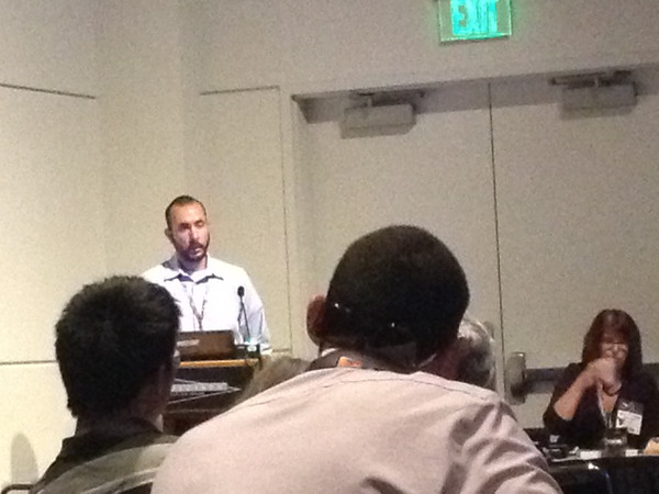 2010 and 2012 intern Habib Bravo-Ruiz presenting at the 2013 annual meeting of the Geological Society of America in Denver, Colo. (Photo/Aisha Morris)