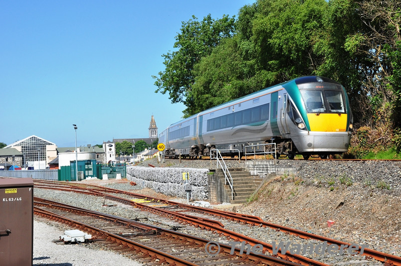 22048 runs down the bank into Killarney with the 20 minute late 1105 Tralee - Mallow. The incoming service had been delayed between Farranfore and Tralee due to a signal fault. Thurs 18.07.13