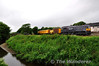071 has just crossed Bridgetown Level Crossing and is about to pass the closed station with the Weedspray train from Waterford to Rosslare Europort. Fri 14.06.13