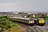 9004 sweeps around the curve at Skerries with the 1235 Belfast Central - Dublin Connolly Enterprise service. 086 stands in the loop with the Tara Mines Train to Alexandra Road. Fri 28.06.13