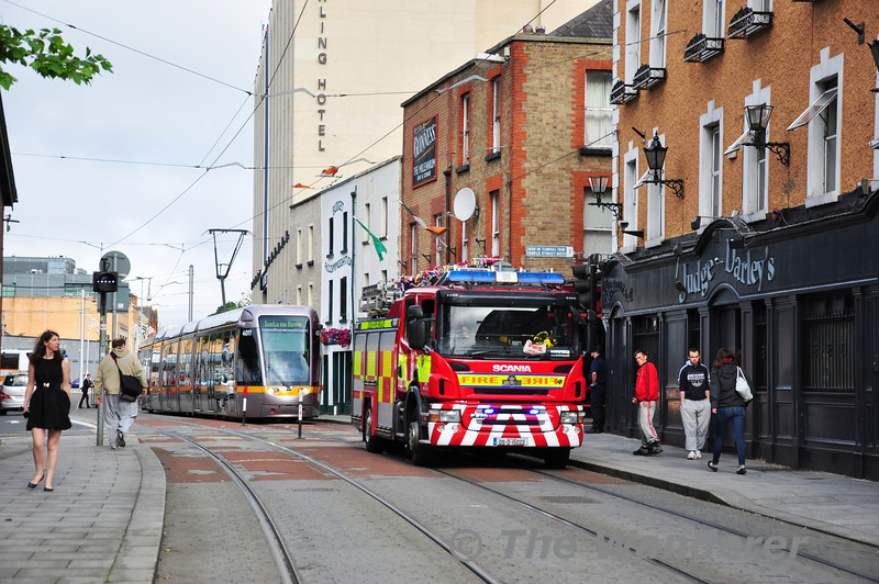 Inbound LUAS Red Line services suffered minor delays on the morning of Friday 28th June 2013 when the Emergency services were called to the Judge Darley's Hotel. 4011 waits for the fire engine to move out of the way. An Ambulance had just left the scene before the photograph was taken.