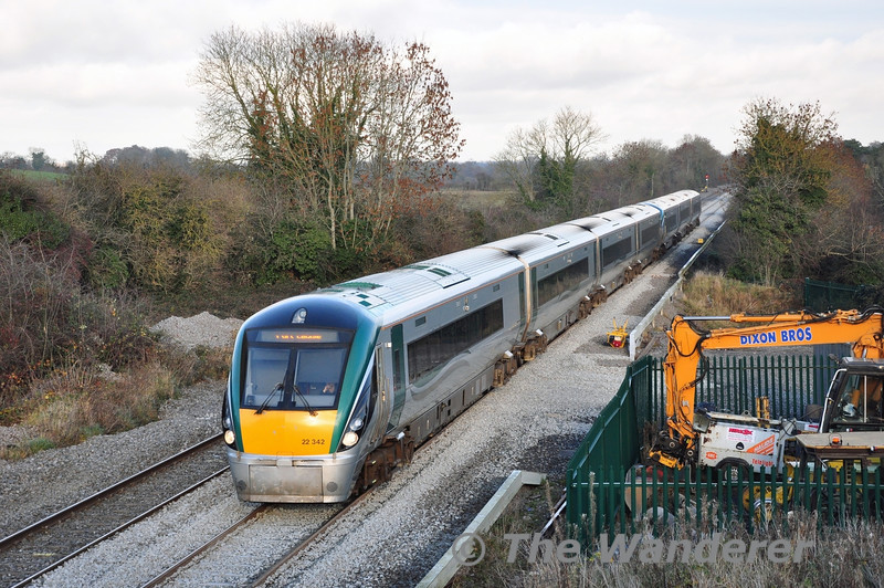 7car 22042 + 22009 pass the Iron Bridge at Sallins with the 1320 Heuston - Portlaoise. Upon arrival at Portlaoise this train would go empty to the nearby train care depot for stabling. Sat 30.11.13