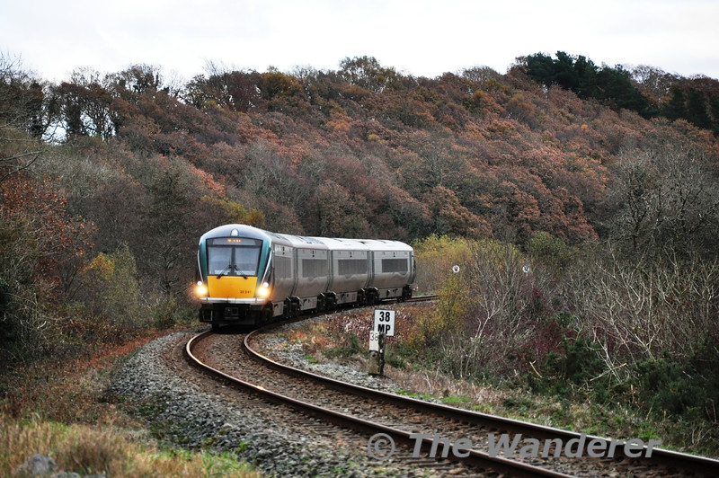 A battered 22041 passes the 38MP at Yellow Quarry on the Tralee Line with the 1210 Cork - Tralee. Sun 24.11.13