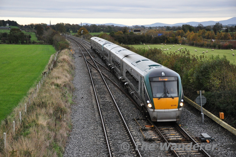 It certainly looked a lot brighter in the East towards Co. Dublin as 22046 + 22050 pass a cloud covered Cherryville Jct. with the 1500 Heuston - Cork. Sun 10.11.13