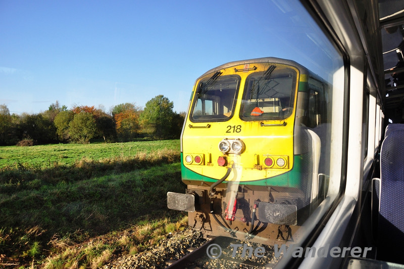 218 at Castlerea with the 0815 Ballina - North Wall IWT Liner. Picture taken from 22306 on the 0735 Heuston - Westport. Fri 01.11.13