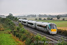 """During the 2nd week of October 22021, 22022 and 22041 were all reformed at Laois Train Care Depot with 22041 losing vehicles 22641 to 22021 and 22741 to 22022. The first 4 car unit entered traffic on Monday 14th October 2013 with 22021 working the 0645 Portlaoise - Heuston, 0800 Heuston - Cork & 1120 Cork - Heuston services.  The 0800 Heuston - Cork is pictured at Carn. 22021 is now formed 22321 + 22421 + 22641 + 22221. Mon 14.10.13 <br> <br>  <a href=""""http://www.flickr.com/photos/finnyus/10268392385"""" target=""""_blank"""">Finnyus</a> caught 22021 at Mourneabbey between Mallow and Cork later in its journey."""