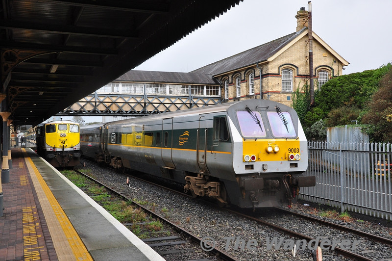 9003 departs from Dundalk with the 1000 Belfast Central - Dublin Connolly. 079 stands in Dundalk's Bay Platform. Sun 20.10.13