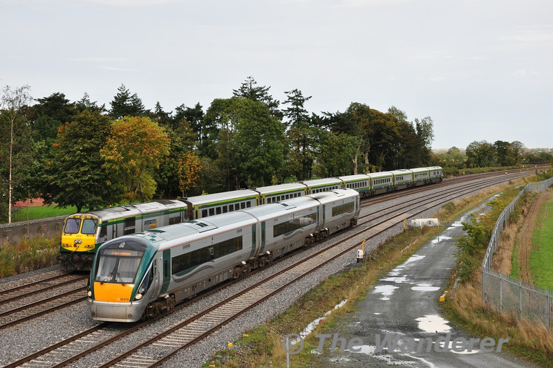 22010 is pictured on the Down Slow with the 1530 Heuston - Portlaoise, while on the Up Fast is 224 propelling the 1320 Cork - Heuston. Stacumny Bridge. Sat 19.10.13