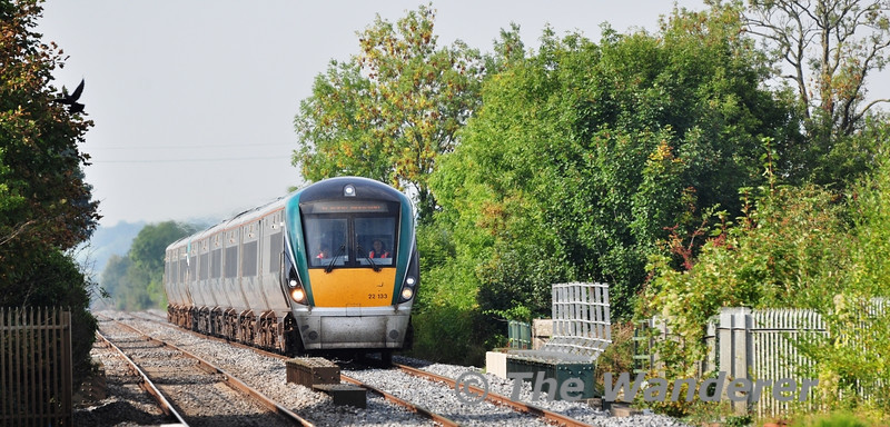 Iarnrod Eireann operated a 9 car ICR Special from Cork to Heuston for the All Ireland Hurling Final Replay between Cork & Clare. 22033 + 22004 bear down on Monastervin at 85 mph, after a signal check at Portarlington, with the 1000 Cork - Heuston Spl. Sat 28.09.13