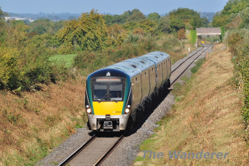 22053 + 22025 pass Ballyavill, near Geashill, with the 0825 Westport - Heuston G.A.A. Special. This set would be returning empty back to Westport at 1205 ex Heuston to form the 1545 Westport - Heuston service. Sun 22.09.13