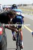 Alberto Contador gets his bike fixed as the peloton saunters along...