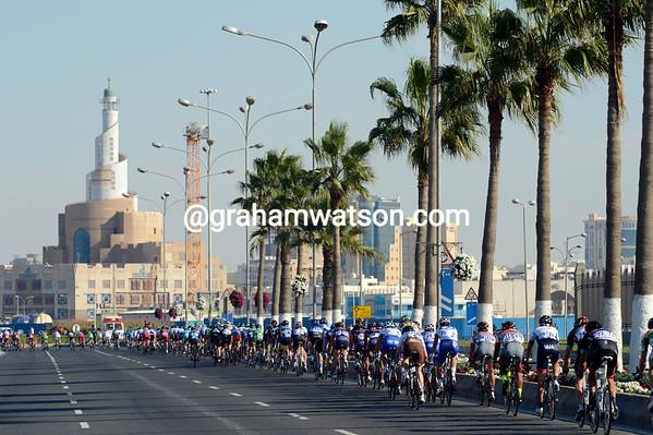Five laps to go for the peloton as it races along the Corniche...