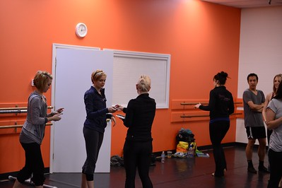 TDA Instructor Training - Tiffany Henderson handing Handing out Twinkle Dust™ and Twinkle Brushes™to Brittany Garza, TDA Costa Mesa director.