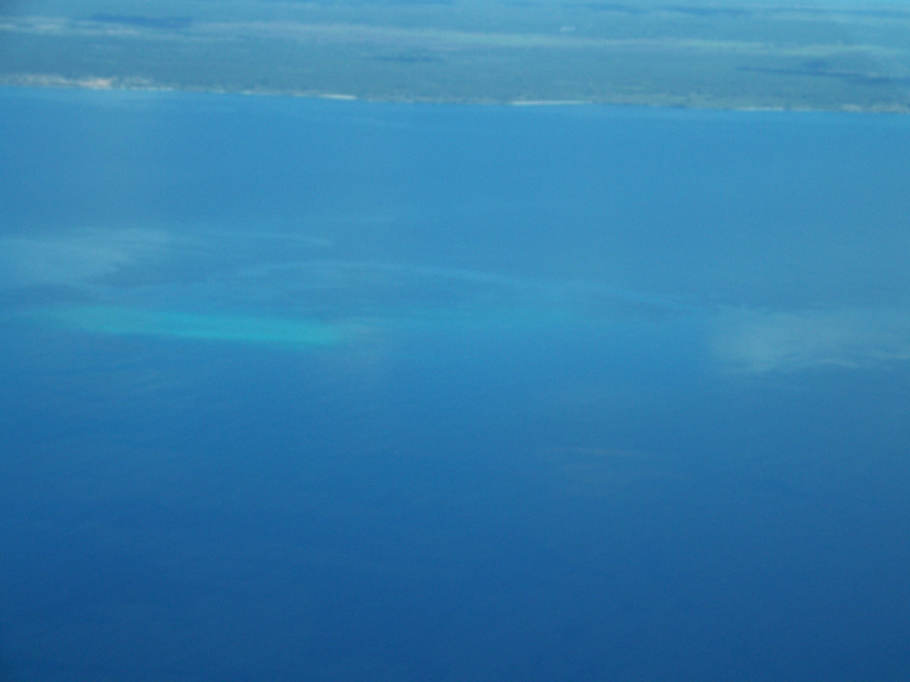 0973 - View of Ocean Between Mainland Tanzania and the Island of Zanzibar from ZanAir Flight Arusha to Zanzibar - Tanzania.JPG