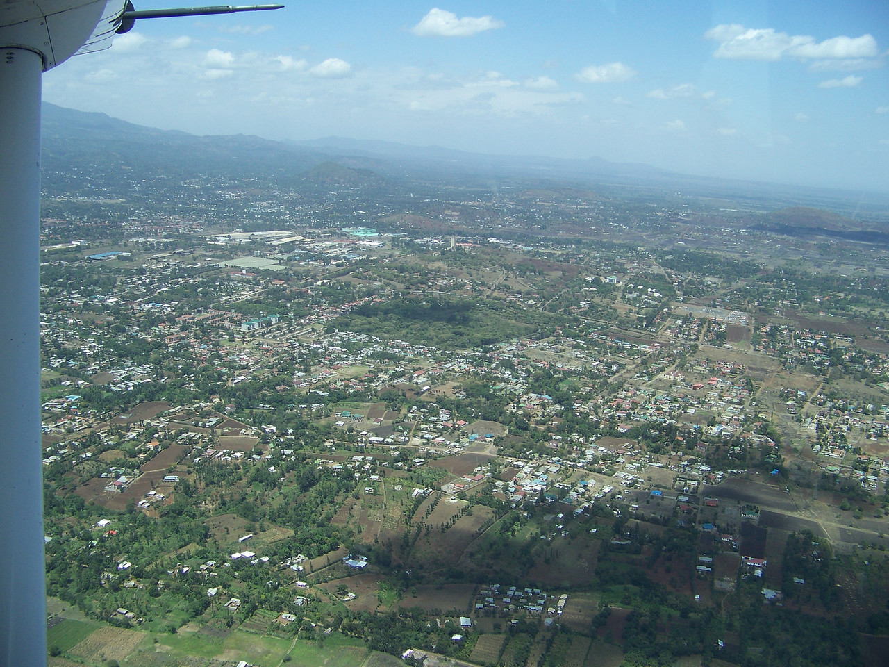 0960 - View of Arusha Area Just After Take Off from Arusha Airport on ZanAir Heading to Zanzibar - Arusha - Tanzania.JPG
