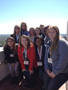 Group sightseeing at the top of the La. State Capitol