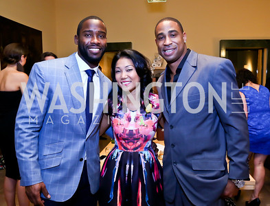 "Washington Redskins wide receiver Pierre Garcon, Becky Lee, Fred Smoot. Photo by Tony Powell. Becky's Fund ""Walk this Way"" Fashion Show. Italian Embassy. November 8, 2013"