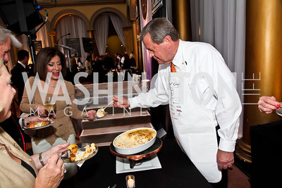 Rep. Tom Latham and serving his hash brown casserole. Photo by Tony Powell. 2013 March of Dimes Gourmet Gala. Building Museum. April 16, 2013