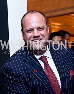 Auctioneer Phil Simonides. Photo by Tony Powell. 2013 Wings of Hope Gala. Trump National Golf Club. November 9, 2013
