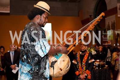 "The ""Kora"" instrument is played while Smithsonian director Johnnetta Cole and the audience listens."